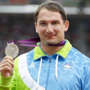 Poletne olimpijske igre 2012. Podelitev medalj, met kladiva, moski. Srebrno medaljo je osvojil slovenski atlet Primoz Kozmus.